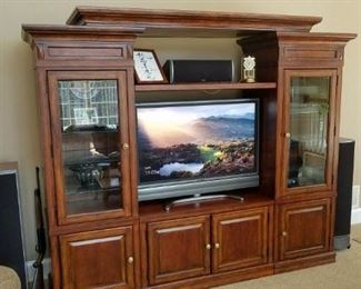 """entertainment unit, 3 piece, can sell sides separately. Made by Mirador. Measures: 95"""" long x 80"""" tall x 21"""" deep."""
