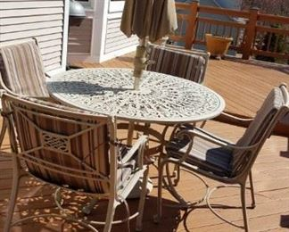 round, metal outdoor table w/ umbrella and 4 chairs
