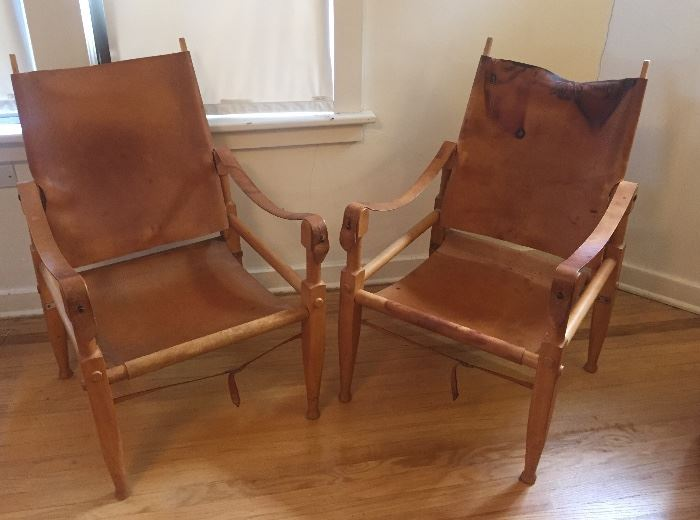 """Pair of Wilhelm Kienzle """"Safari"""" chairs, leather & wood (one chair AS FOUND - leather stained) Note: These are NOT by Kaare Klint as previously stated."""