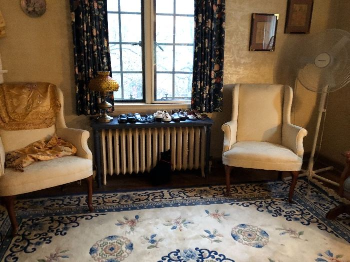 pair of wing chairs & Chinese wool rug