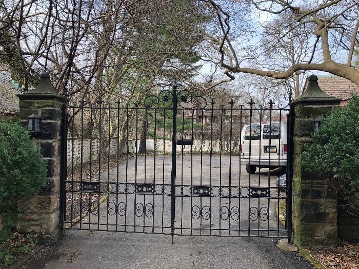 The iron gates are an architectural feature of the property and are not for sale