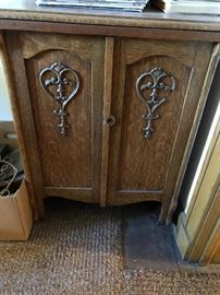 antique oak cabinet in attic