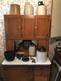 Hoosier cupboard in great condition/ antique crocks