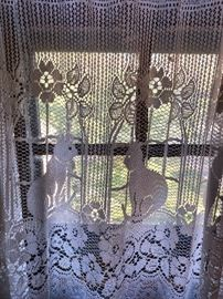 lacy cat curtains with brass cat finials