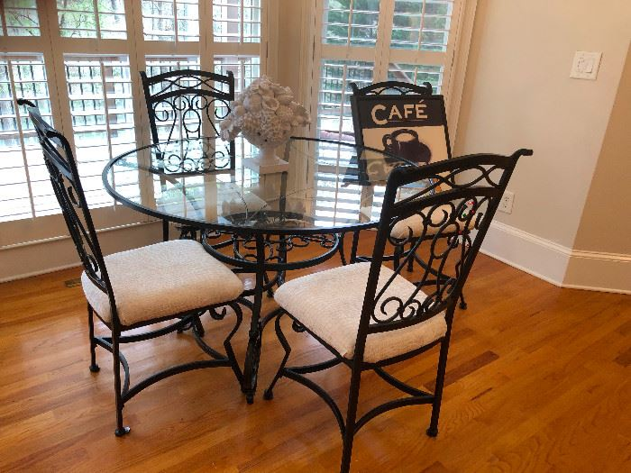 Ornate wrought iron glass-top dinette set dining Ashley Furniture