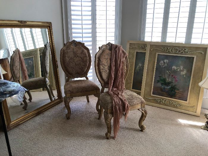 Chairs, mirror, art, oh my!