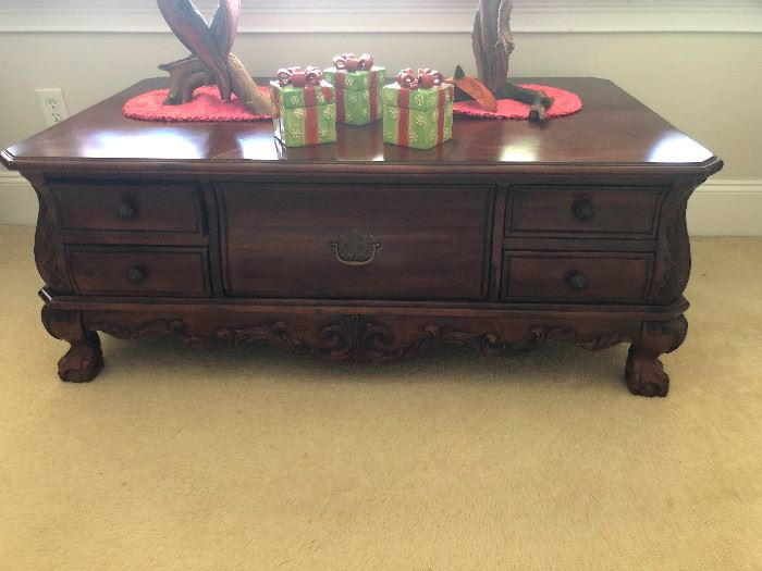What is that? It's not a coffee table, it's not a parlor table -- it's not a table at all, is it? Is it a dresser that got put under a spell by a vengeful gypsy? Please come Thursday and tell me!