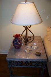 One of a pair, iron and marble end tables
