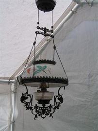 retractable  oil lamp is iron & brass and glass also has  metal DRAGONS