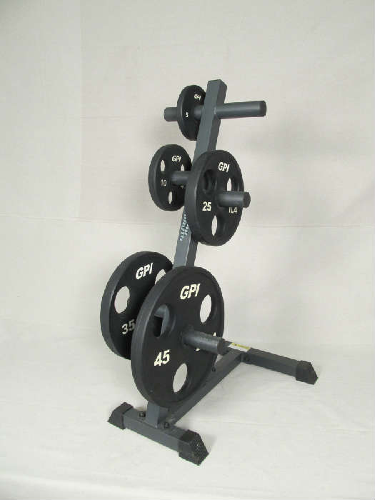 Set of free weights (4 x 45 lbs, 2 x 35 lbs, 2 x 25 lbs, 4 x 10 lbs, 2 x 5 lbs) and 8 arm tower.