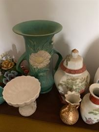Roseville pottery and porcelain pieces.