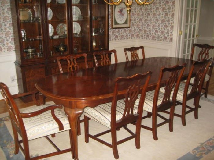 Queen Anne dining table with 2 leaves.  8 Chippendale style chairs sold separately from the table