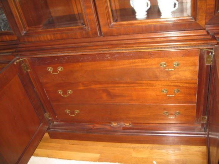 breakfront drawers hidden behind doors