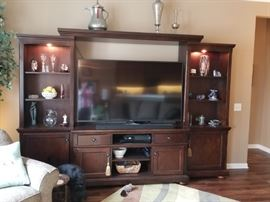 "Ashley Entertainment Center - holds 65"" television  9.5' wide x 21"" deep  $600"