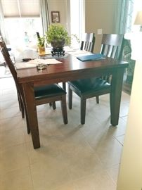 "Ashley table  60"" x 42"" one butterfly leaf stored in table with 6 chairs $598"
