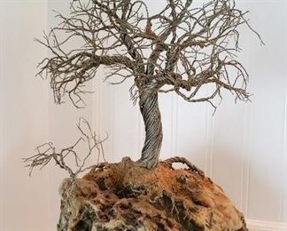brutalist twisted wire tree on rock base