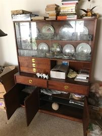 Oil Walnut Display cabinets with brass draw pulls and  leather pulls on cabinet door