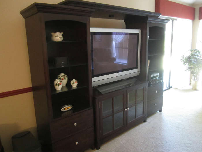 Lovely Entertainment Center, Large Plasma TV and Bose System.  Sold Separately