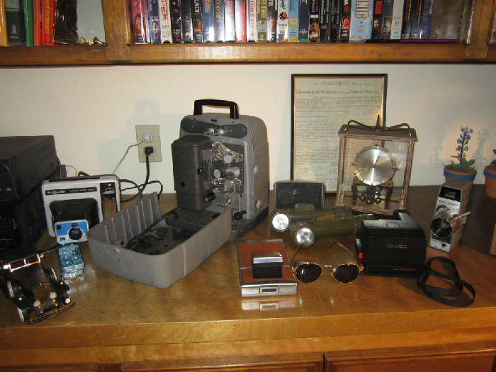 Bell & Howell Projector, Movie Camera, Olive Kel-lite Flashlight, Kundo Clock, Polaroid SX-70 Land Camera