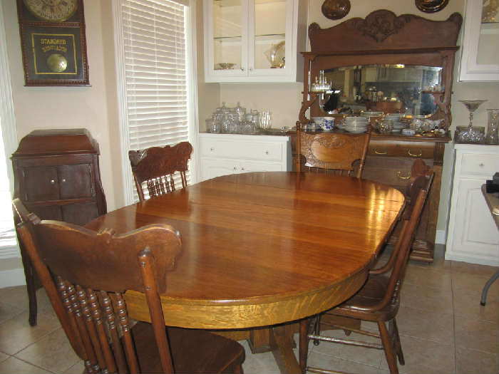 Gorgeous Oak Table With 4 Leaves. Chairs Are Beautiful Too and are sole separately.
