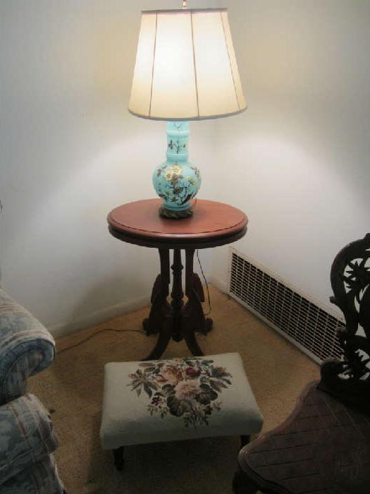 Sweet small Eastlake Table with lamp and needlepointed small ottoman