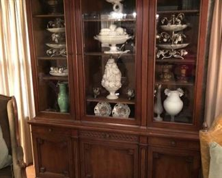 Mahogany china cabinet with pullout serving table.  Full of 1950's  Capodimonte and other Italian vintage pottery pieces