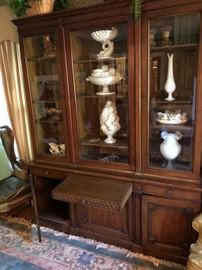 Drexel Heritage China Cabinet with 3 full opening doors and a pullout vallet. 3 cabinets onthe bottom