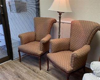 Pair of petite winged back chairs.  Floor lamp.