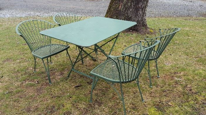 Incredible vintage outdoor piece. Folding table and chairs -- great lines, great vintage green color.
