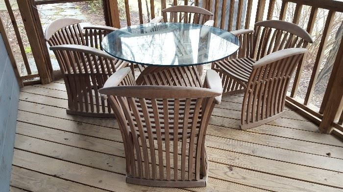 Mid-Century style! Gorgeous vintage teak glass top table and chairs. A true statement piece.