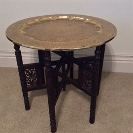 "Brass Table with Folding Legs, 23 1/2"" diameter."