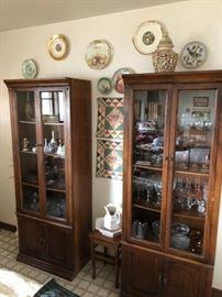 two curio cabinets glassware