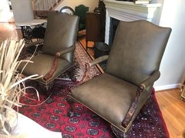 PAIR OF HENREDON LEATHER CHAIRS WITH CARVED WOOD DETAILING ON ARMS AND LEGS