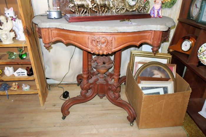 Antique carved table with rabbit in center