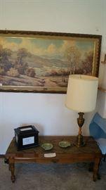 coffee table, lamp, wall hanging