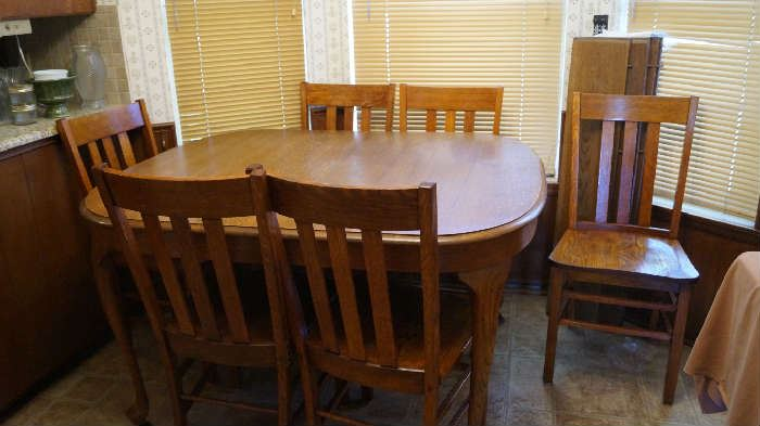 antique oak table with 6 chairs and several leaves (has seated up to 30 with all the leaves)