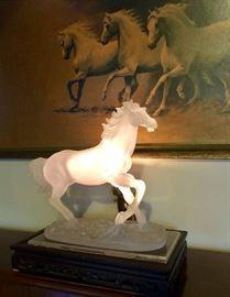 Backlit crystalline horse on stand
