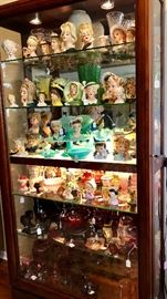 A stunning collection of Vintage Lady Head vases and aqua milk glass, unfortunately, this case isn't for sale.