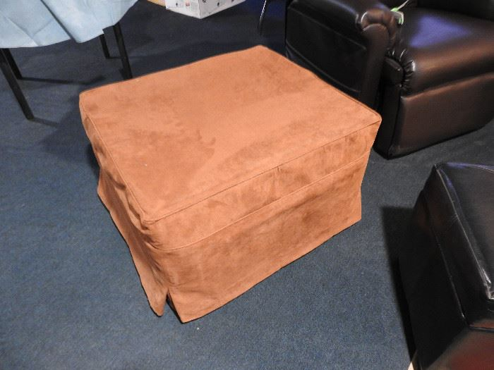 Ottoman folds out to make a bed