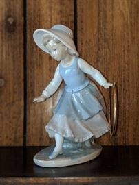 $100 Lladro girl with hoop