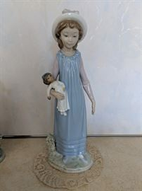 $75 Lladro girl with doll
