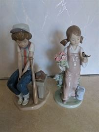 $100 each Lladro girl with bird and flowers    Lladro boy with bat
