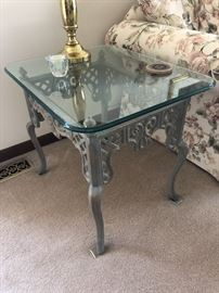 Wrought iron end table with glass top, rounded edges