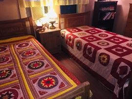 Many fine quilts, embroidered linens, and crocheted lace