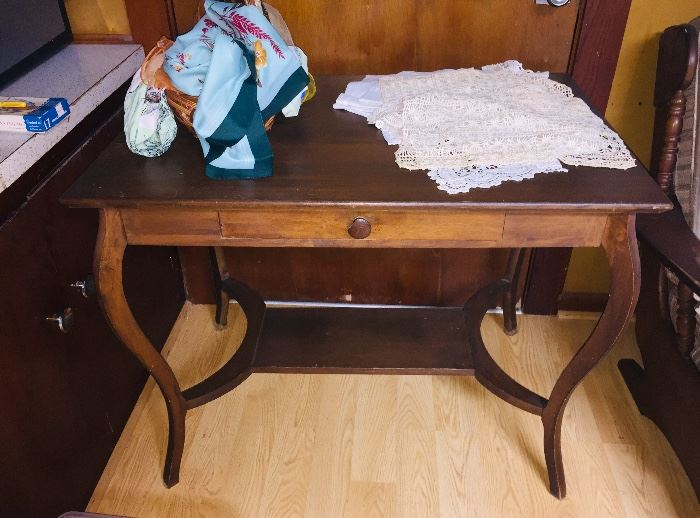 we have lace, early handkerchiefs, table cloths, quilts--everything vintage