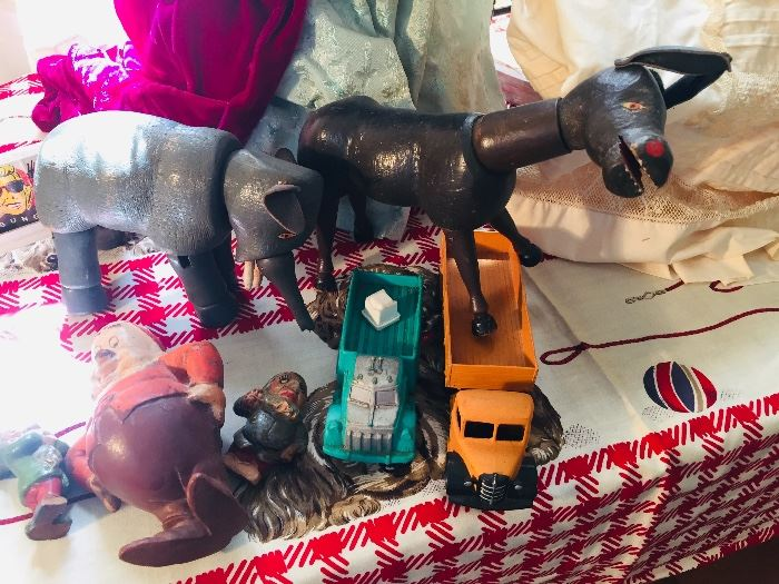 early wooden toys, metal trucks and do you see the 1938 Disney dwarf?--there's many more toys being discovered daily