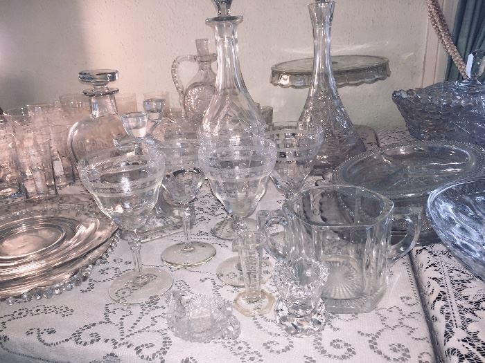 two long tables featuring 20th century crystal including American Fostoria