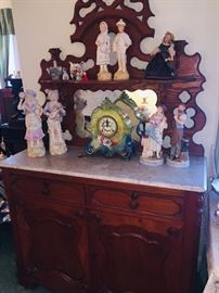 marble top side boards and do you see just a few of the figurines-