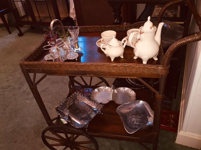 early wicker tea cart and we have tonnage of early silverplate and aluminum ware