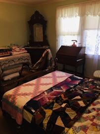 another view of little Walnut and marble dresser, the beautiful quilts, and a precious little writing desk